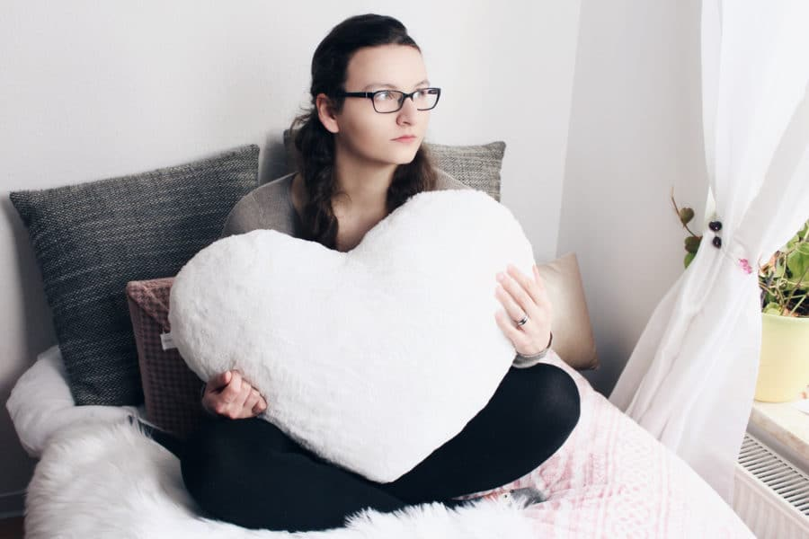 Girl with heart pillow